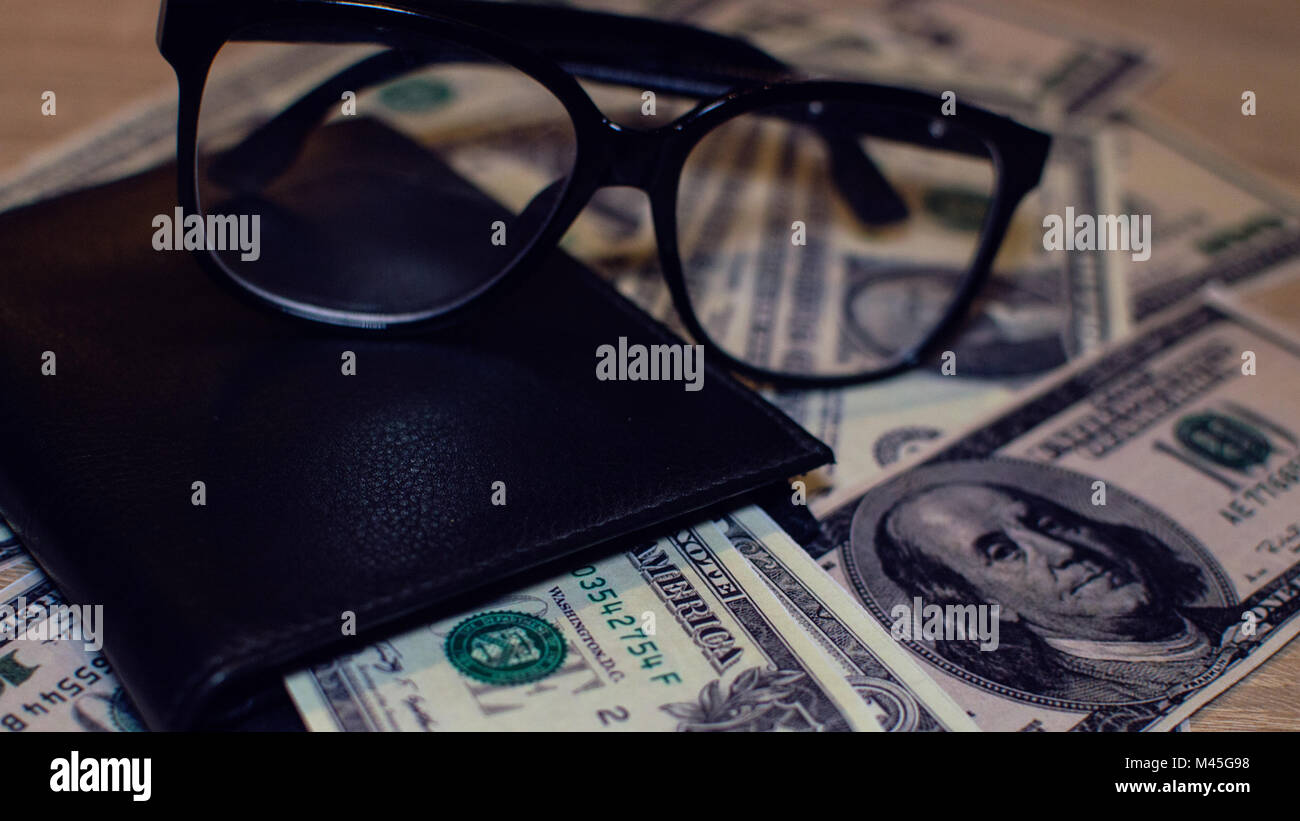 Financial balance with dollars in year 2018 - Stock Image