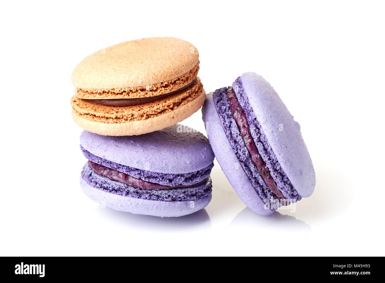 Violet and beige macarons on white - Stock Image