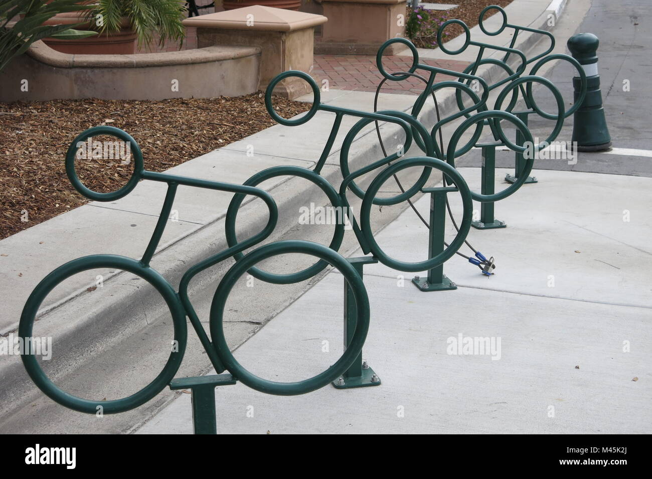 Cycle racks add to the street furniture on Coronado Island, San Diego - Stock Image