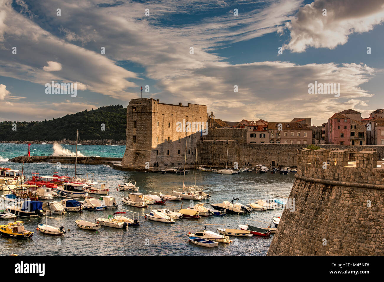 Port and city walls at sunset, Dubrovnik, Croatia - Stock Image