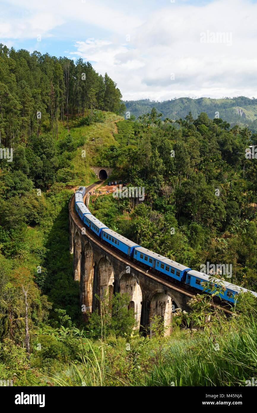 Train on the Nine Arches Bridge in the highlands near Ella,Sri Lanka Stock Photo