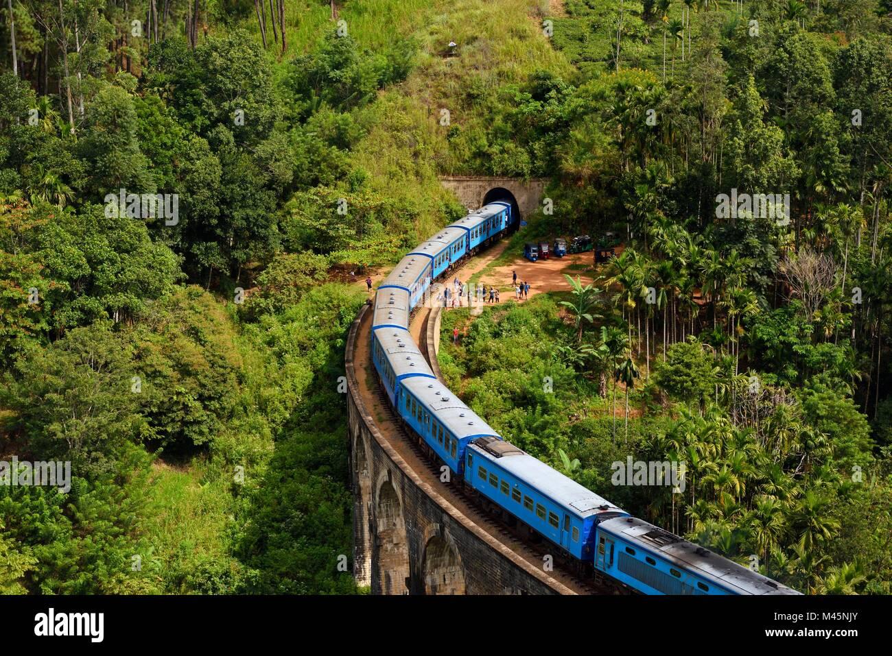 Train on the Nine Arches Bridge in the highlands near Ella,Sri Lanka - Stock Image