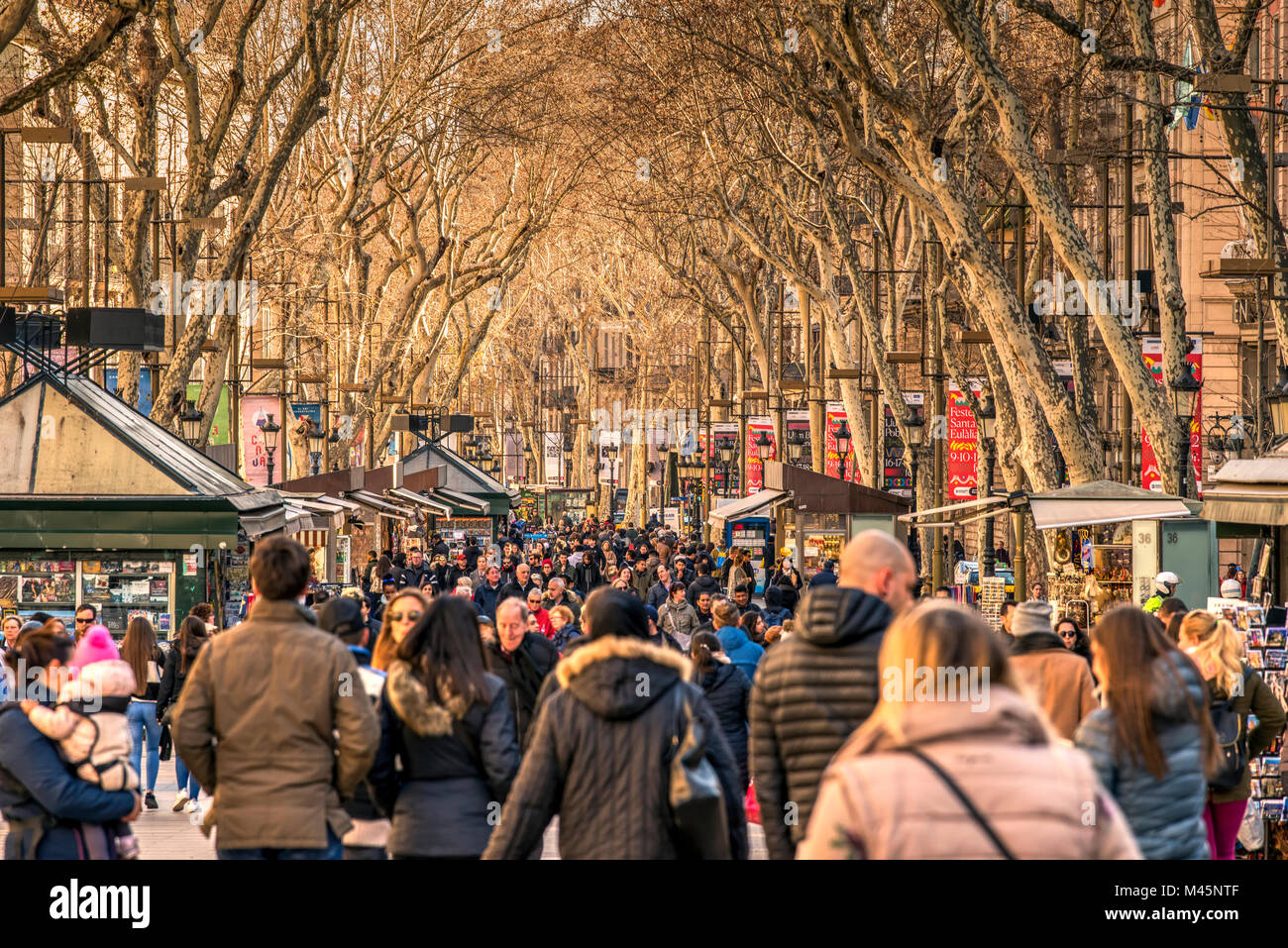 Tourists strolling on the famous Rambla pedestrian mall, Barcelona, Catalonia, Spain - Stock Image
