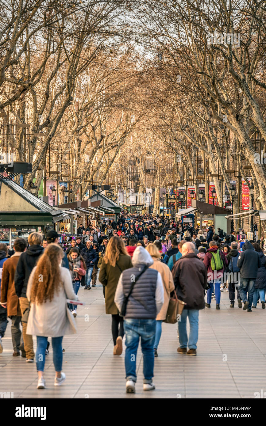 Tourists strolling on the famous Rambla pedestrian mall, Barcelona, Catalonia, Spain - Stock Image