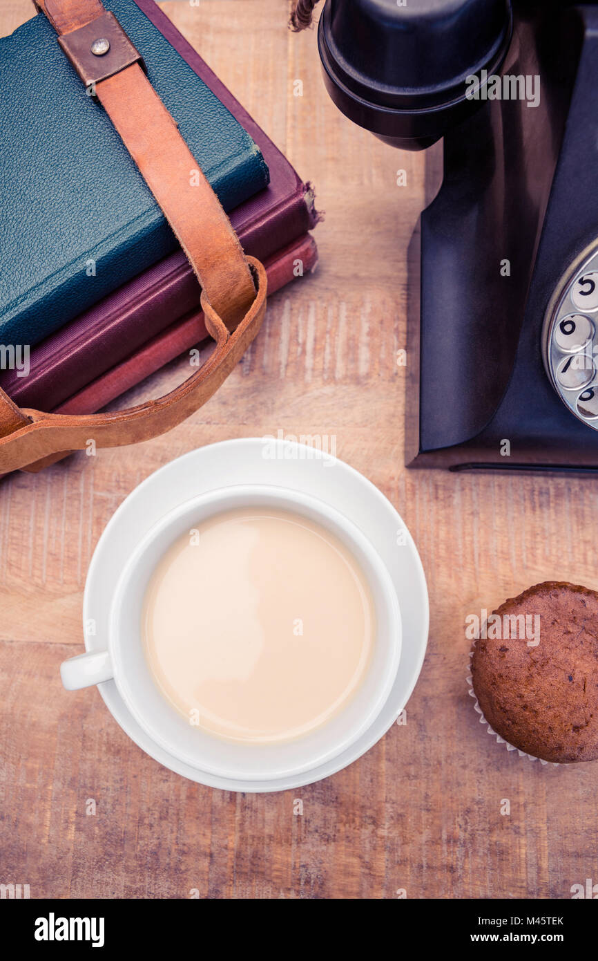 Coffee with old landline telephone and diaries - Stock Image