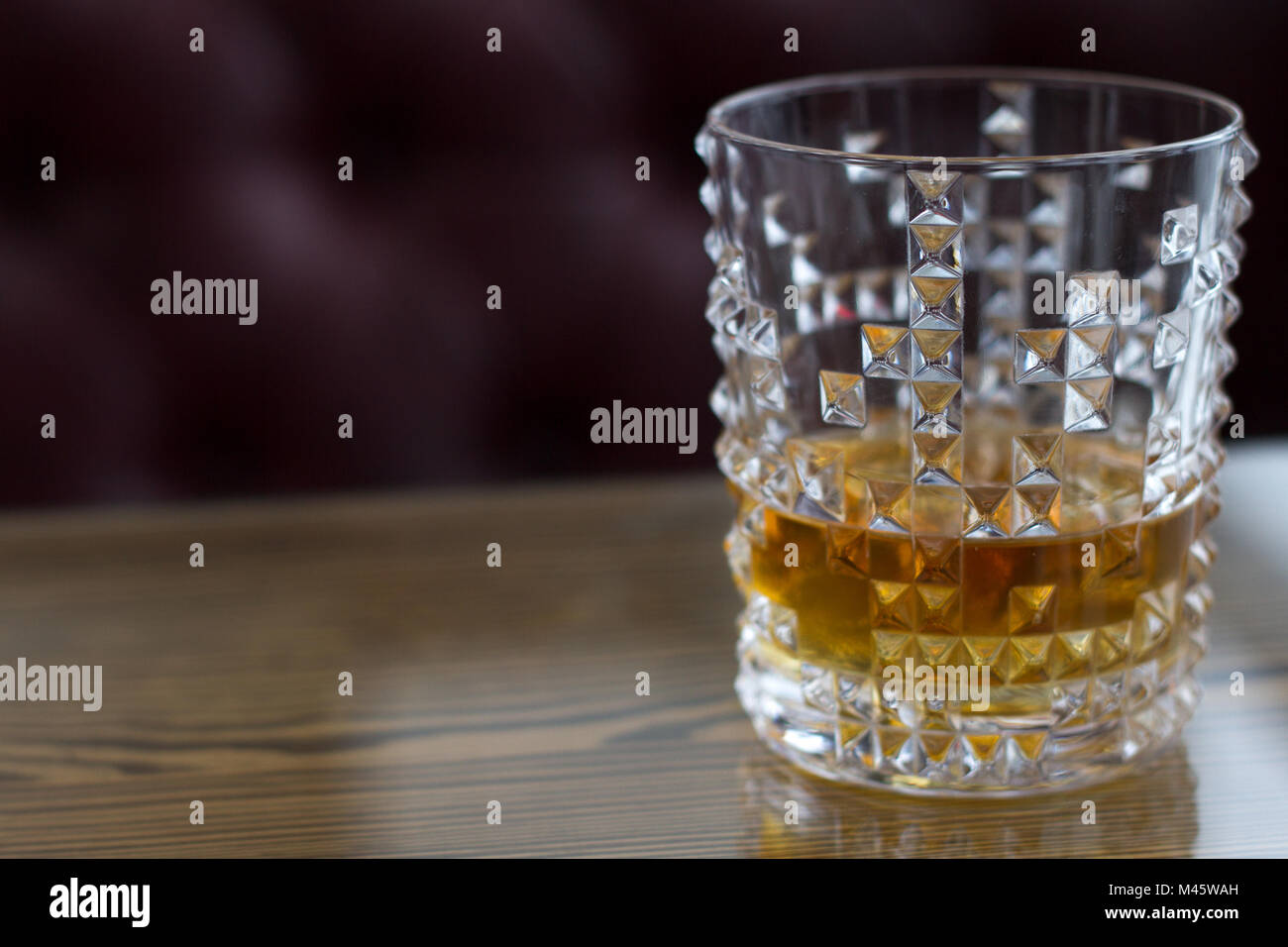 Whiskey In A Glass On The Background Of A Leather Sofa Stock Photo:  174691961   Alamy