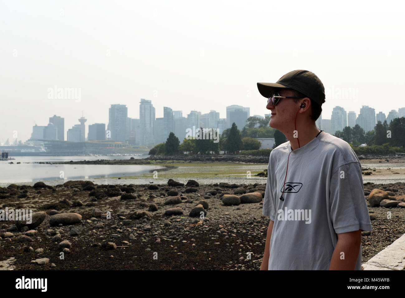 view of the Vancouver skyline from Stanley Park, British Columbia, Canada.  The view is hazy due to the wild fires - Stock Image