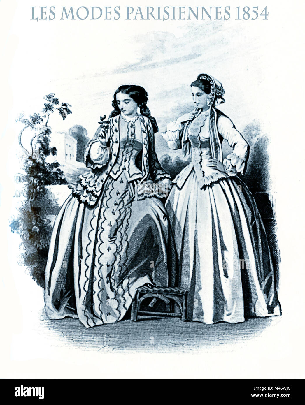 1854 vintage fashion, French magazine Les Modes Parisiennes presents two ladies walking leisurely  in garden with - Stock Image