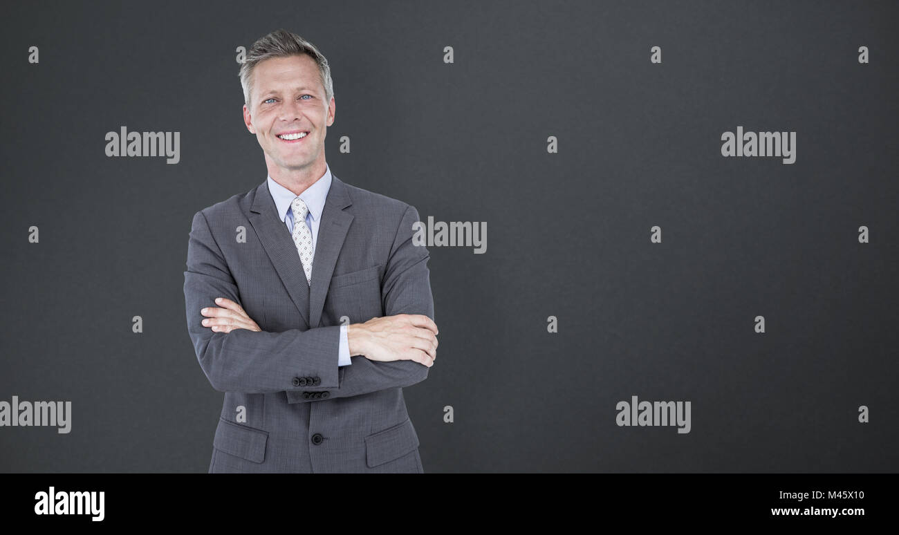 Composite image of portrait of smiling businessman standing arms crossed Stock Photo
