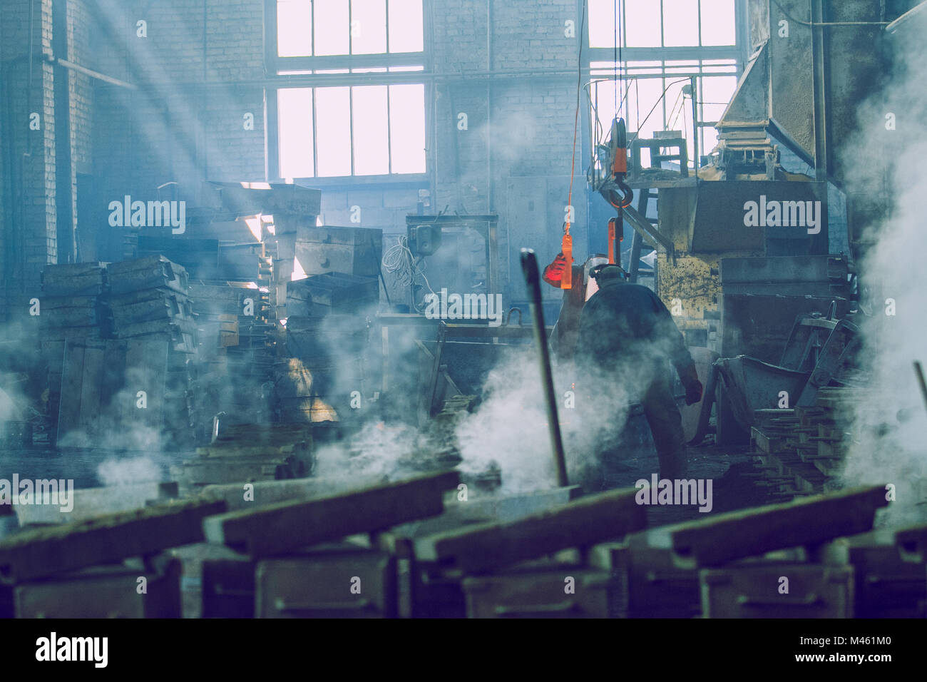 Cesis, Latvia, Metal foundry, workers pour metal, factory in city Cesis 2011. Stock Photo