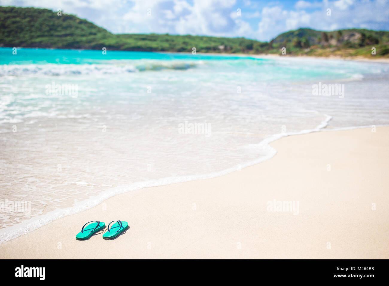 b756b7c2c Summer mint flipflops with sunglasses on white beach Stock Photo ...