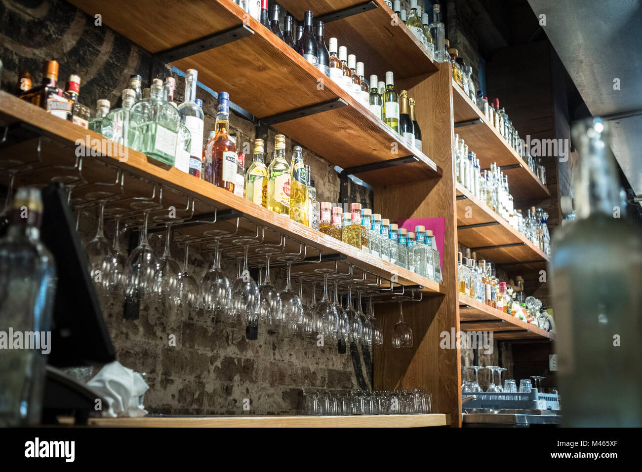 Bottles and glasses at the bar in Mejico, Sydney. - Stock Image