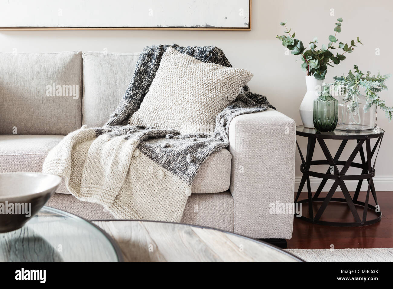 Textured layers interior styling of cushion sofa dn throw in nuetral ...