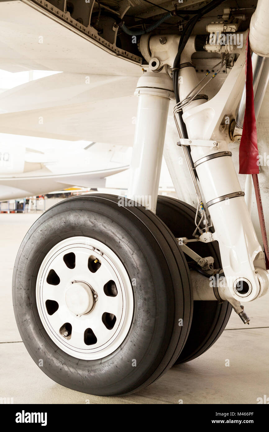 Detail of the wheel and landing gear on a jet - Stock Image