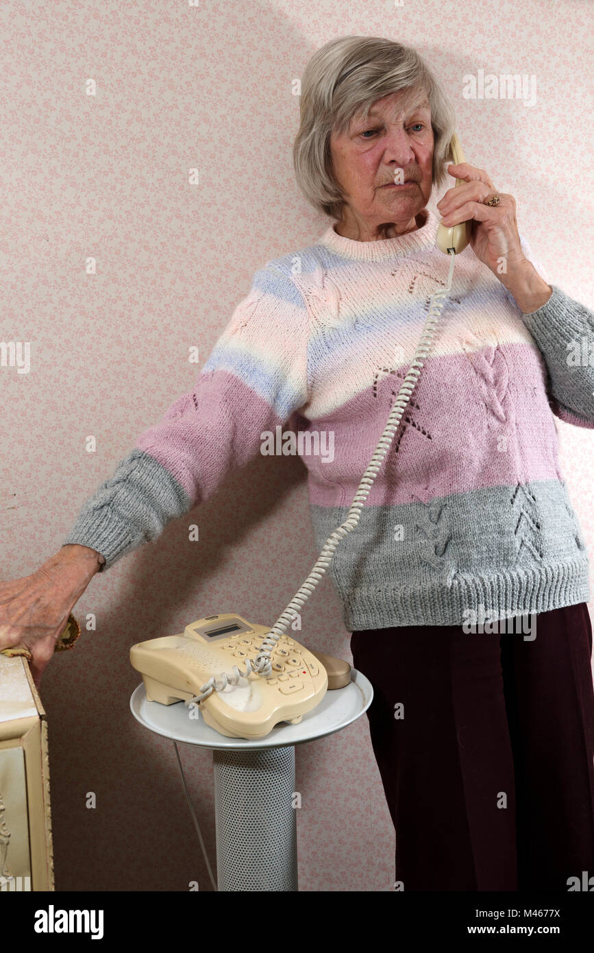 Elderly woman waiting on the telephone - Stock Image