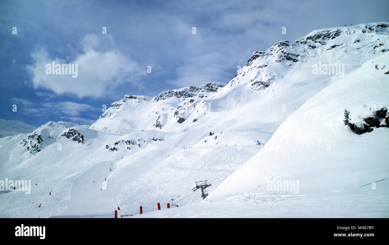 Panoramic alpine winter landscape of slopes, off piste skiing, chair lifts, in the highest French resort of Val - Stock Image