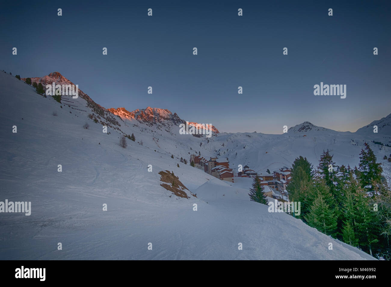 Winter sunset landscape at Belle Plagne ski resort in La Plagne, Savoie, France. Credit: Malcolm Park/Alamy. Stock Photo