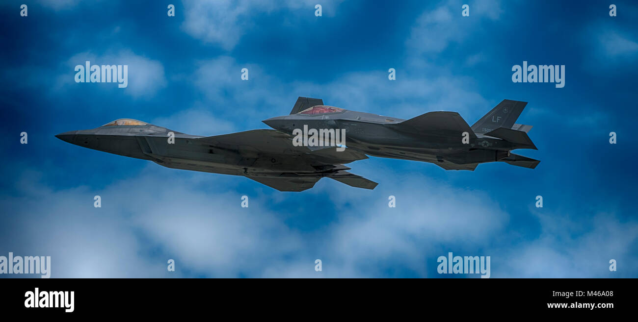 Lockheed Martin F22 Raptor and F-35 Lightning II flying side-by-side at RIAT, RAF Fairford, UK. Credit: Malcolm - Stock Image