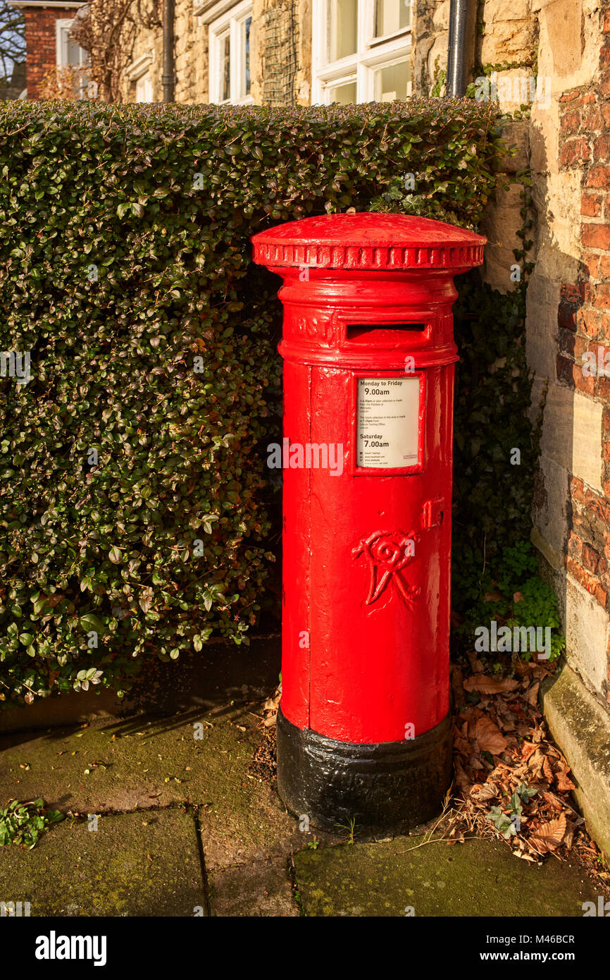A Victorian red posting box near to Lincoln Cathedral - Stock Image