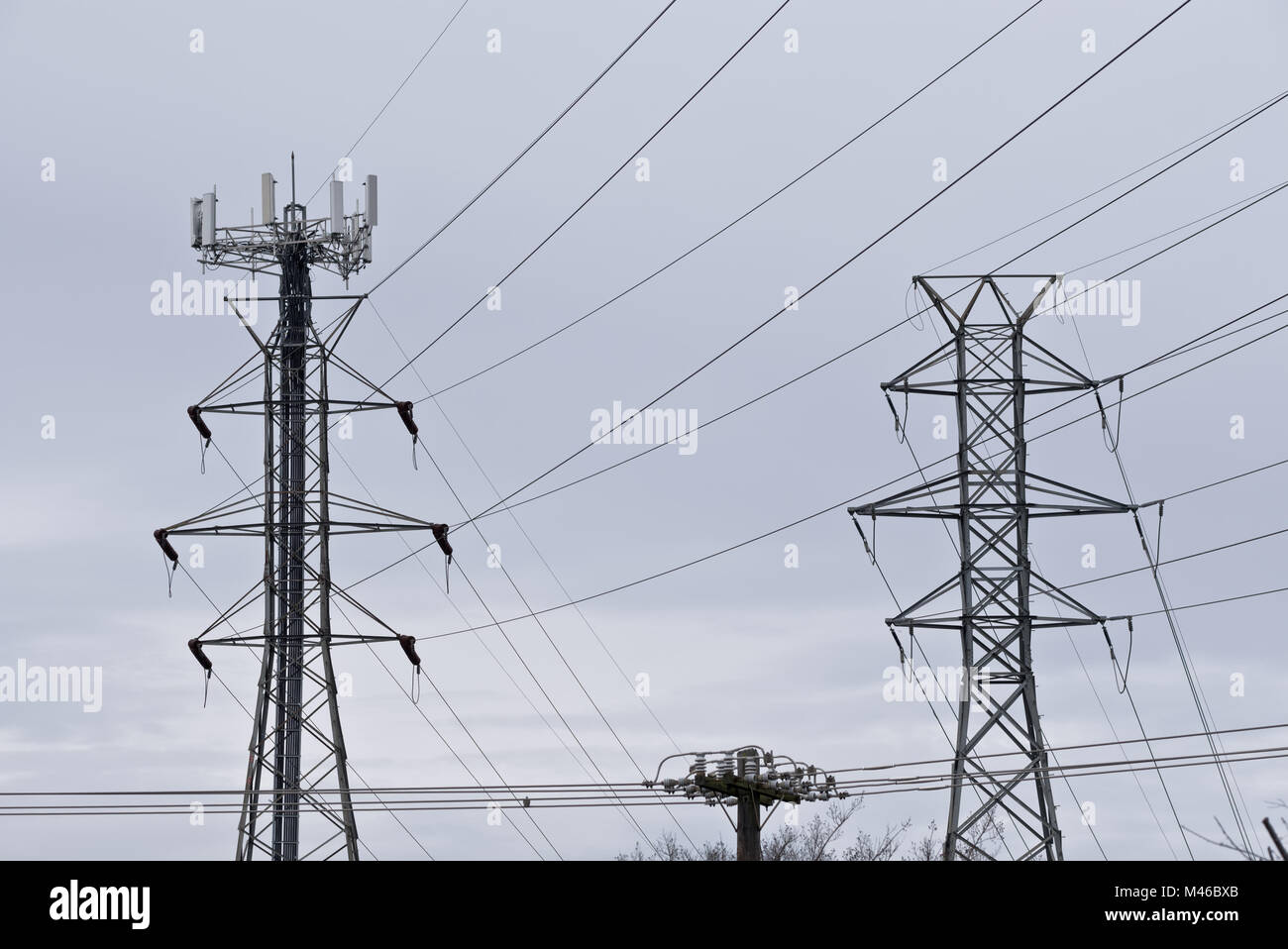 Communication Antennas On Electrical Power Transmission Line Towers Stock Photo Alamy