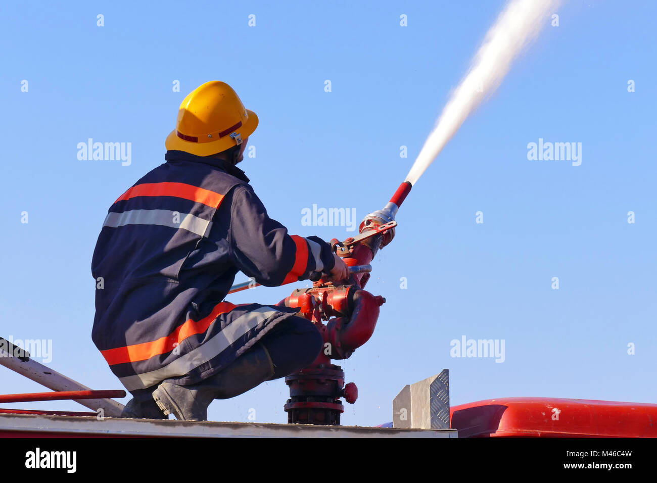 Fire fighting with water cannon - Stock Image