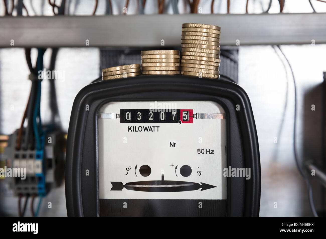 Close-up Of A Stacked Coin Measuring On Kilowatt Electricity Meter - Stock Image