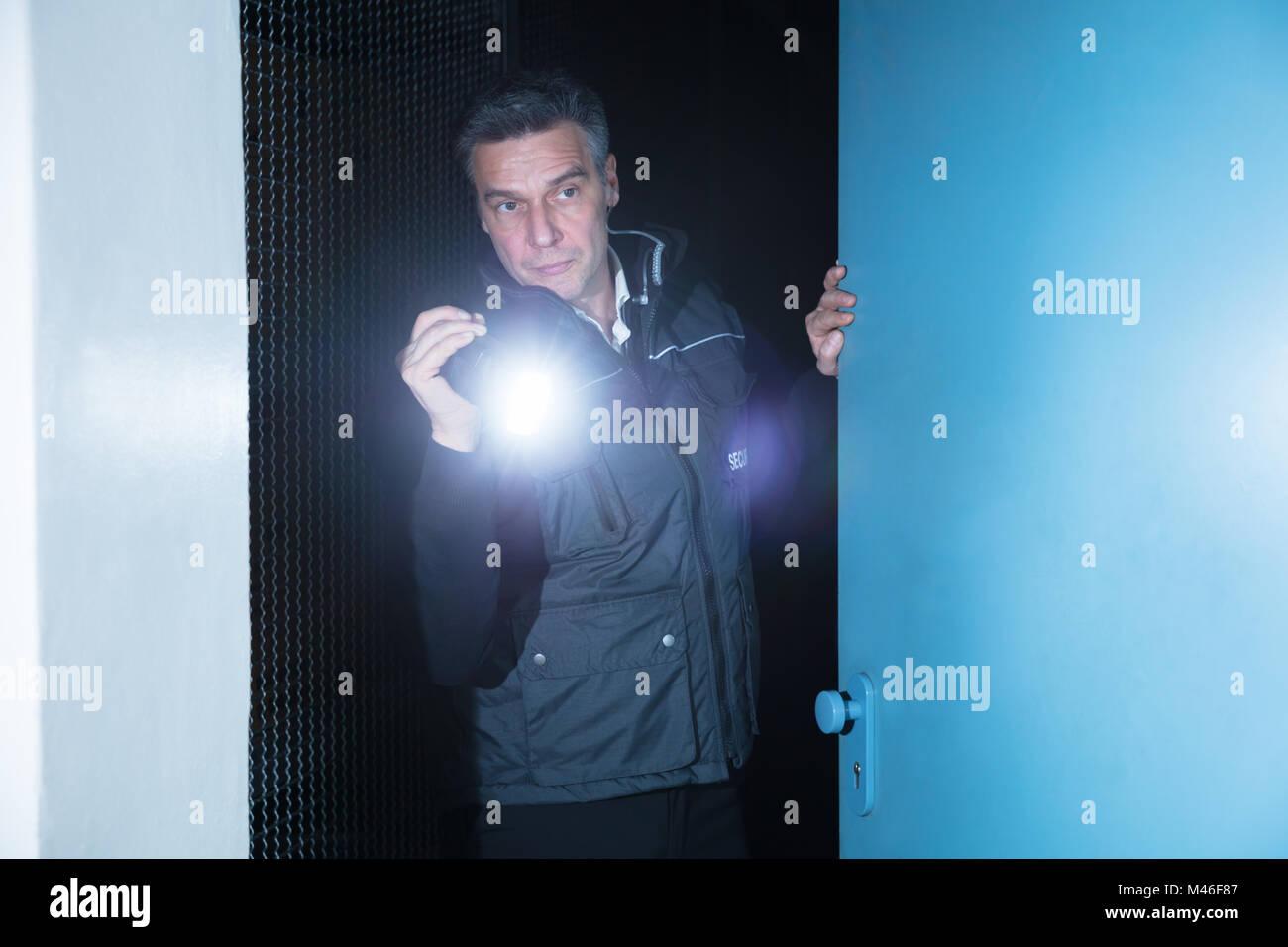 Guy using flashlight