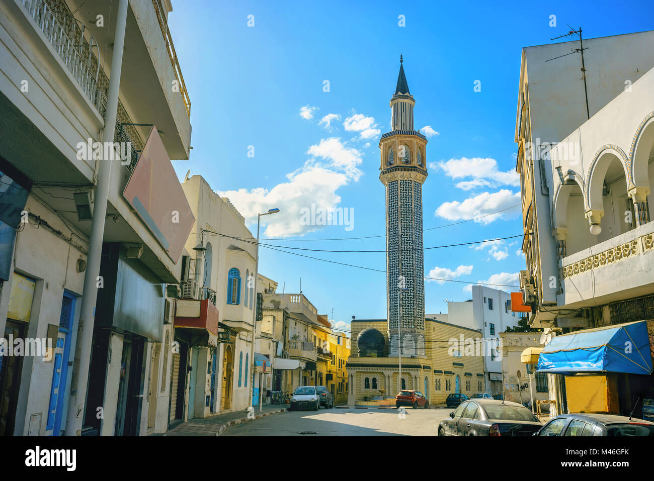 Cityscape with tall minaret tower of mosque  in Nabeul. Tunisia - Stock Image