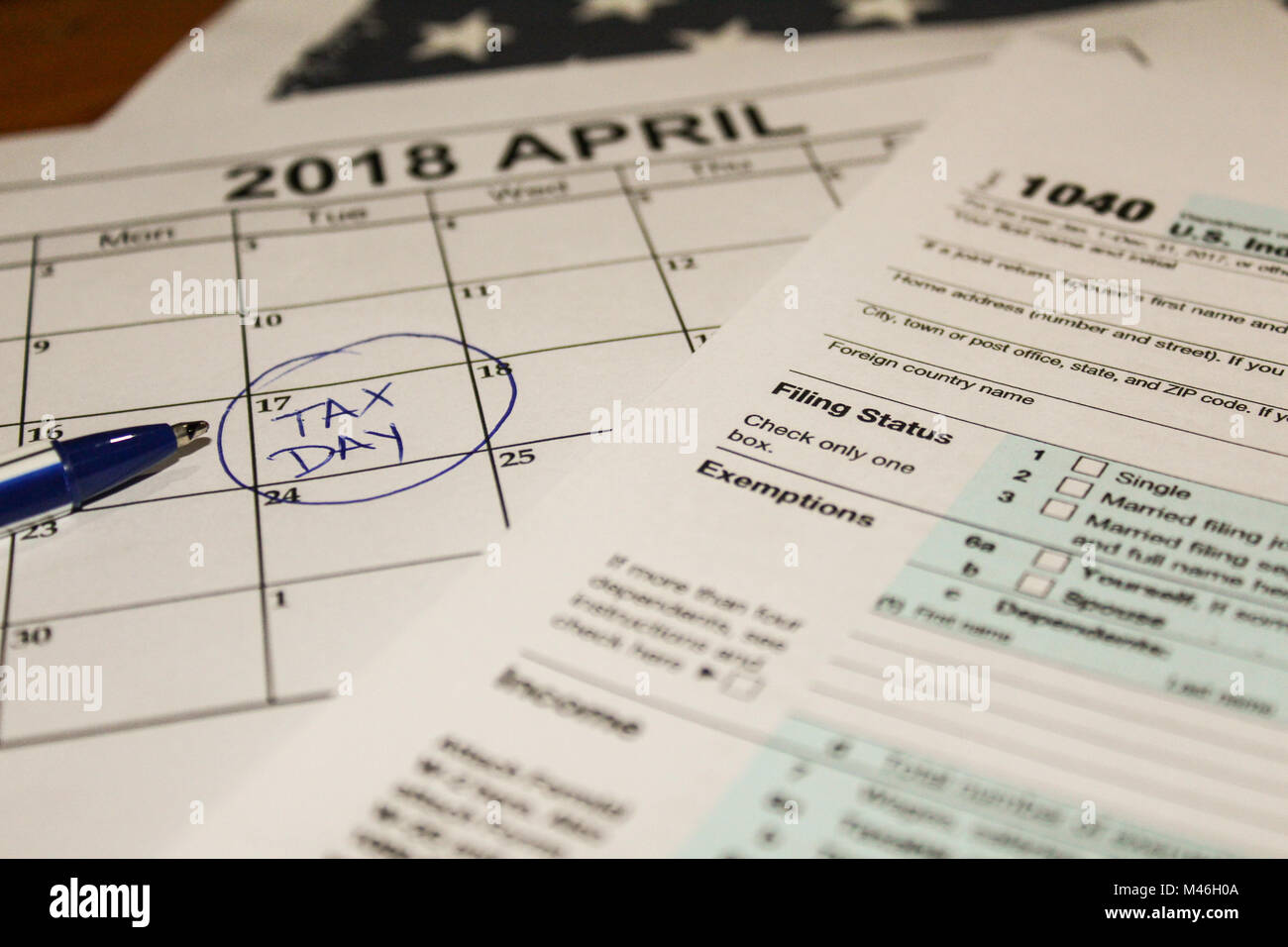 Calendar and form 1040 income tax form for 2017 showing tax day for filing is April 17 2018 Stock Photo