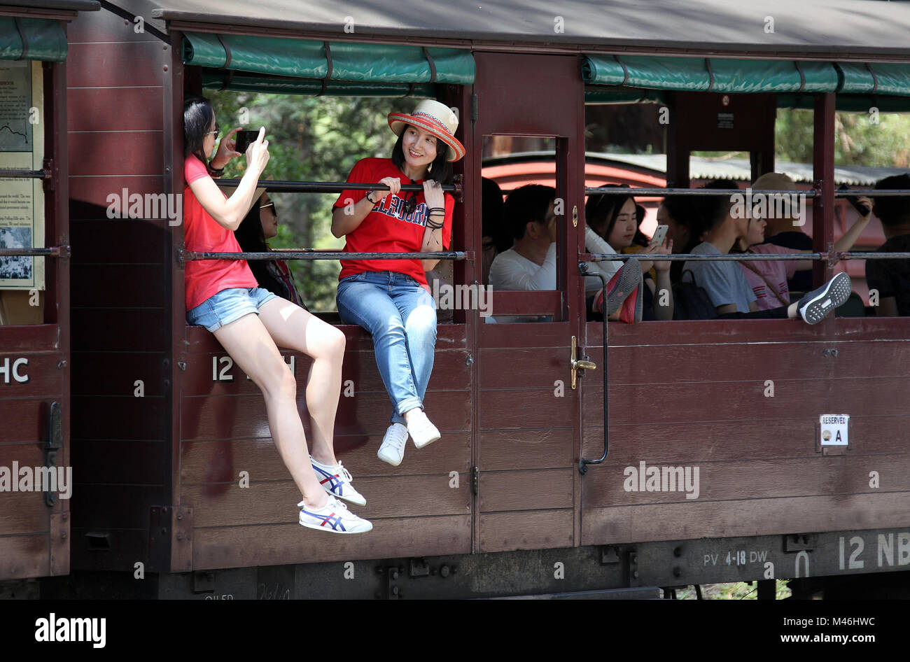 Tourists aboard Puffing Billy Steam Train at Melbourne - Stock Image