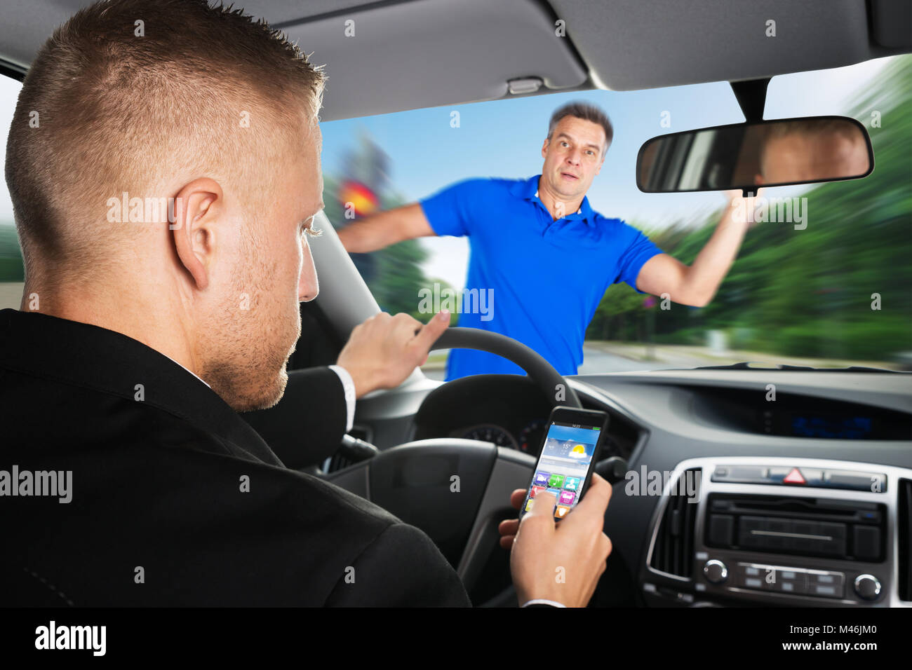 An Irresponsible Driver Is About To Run Over A Pedestrian While Using Mobilephone - Stock Image