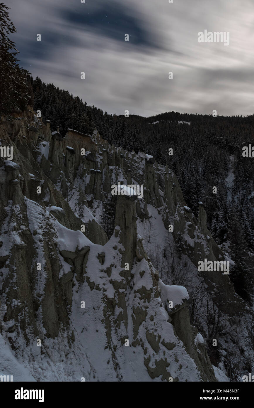 Perca/Percha, province of Bolzano, South Tyrol, Italy, Europe. Full moon night at the Earth Pyramids Stock Photo