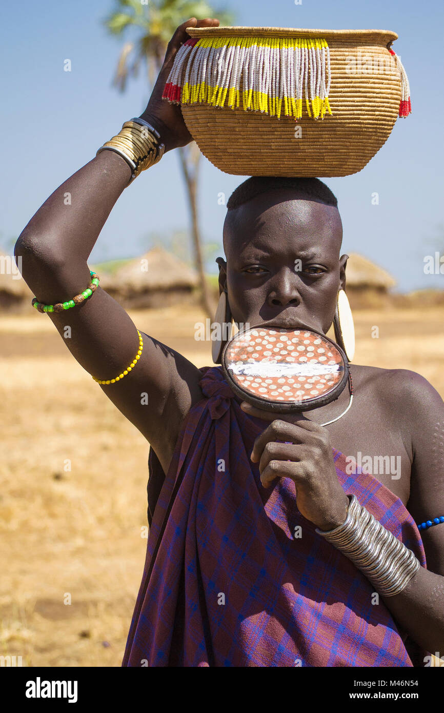 Mursi woman with labial plate, ethnic minorities of the lower Omo valley - Ethiopia. © Antonio Ciufo - Stock Image