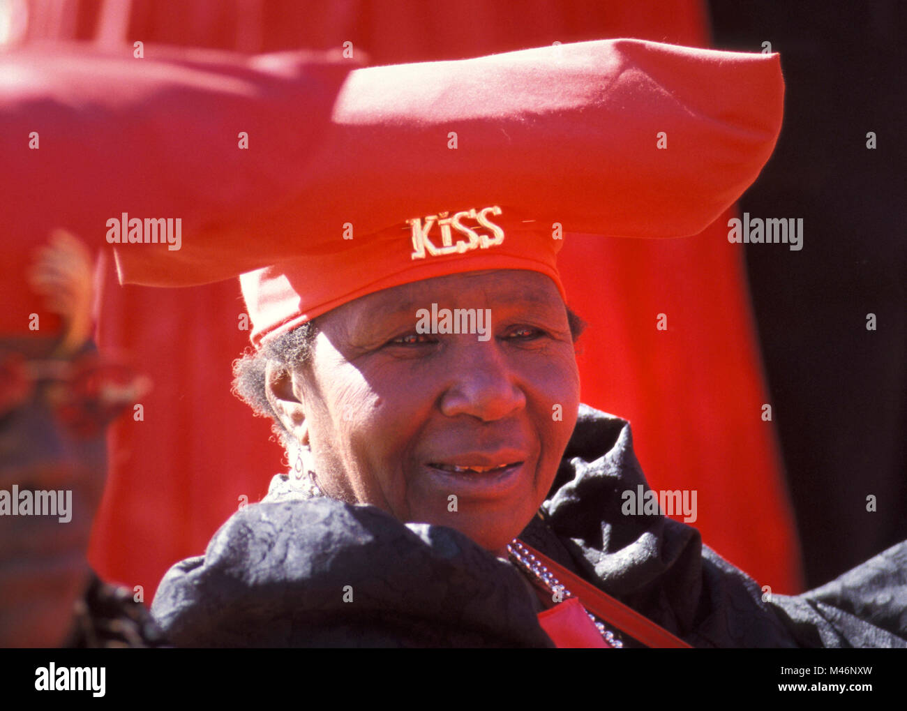 Namibia. Kaokoveld, near Opuwo. Herero woman.  Typical Vicotorian dress and hat, influenced by German missionaries' - Stock Image