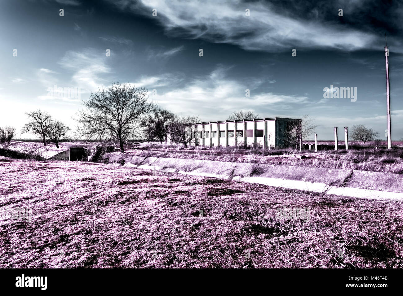 Abandoned electric station in infrared colors. Post-apocalyptic infrared landscape. - Stock Image