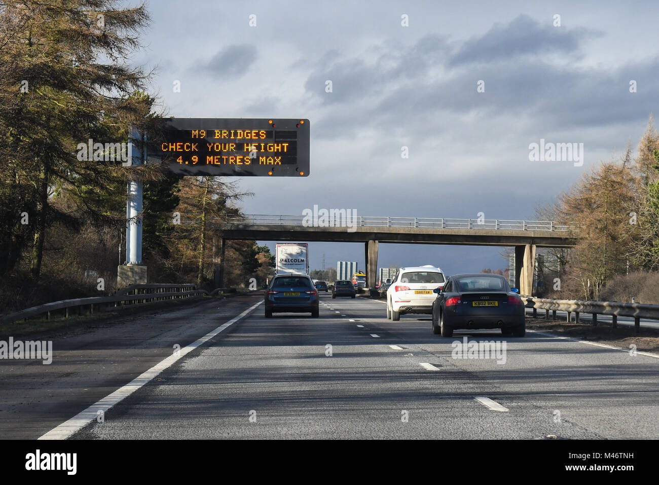 motorway bridge height warning sign on M9 motorway, Scotland, UK - Stock Image