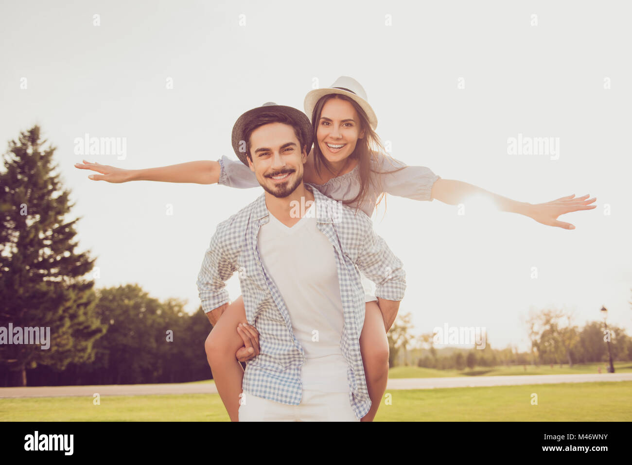 Date outside, well dressed, excited, lovely. Good day, happiness, friendship, stroll, holiday, fly, freedom concept. - Stock Image