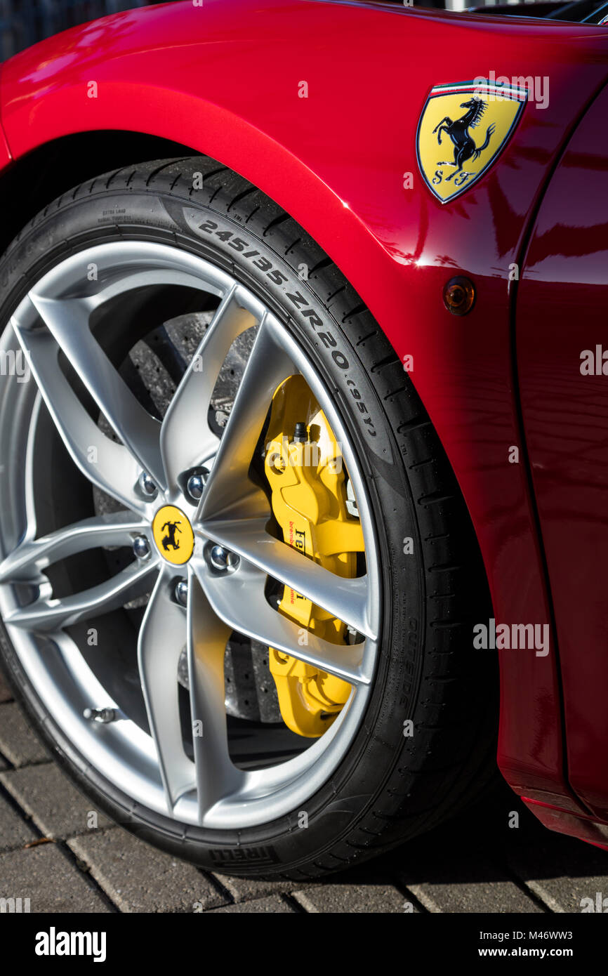 Front wheel and brake details of a Ferrari 458 sports car on display at the 'Cars on 5th' autoshow, Naples, - Stock Image