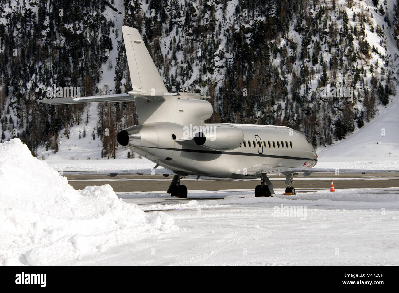 A private jet in the airport of St Moritz in the alps switzerland in winter - Stock Image