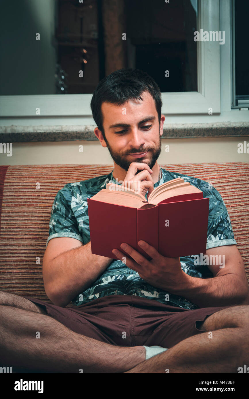 Reading a great book - Stock Image