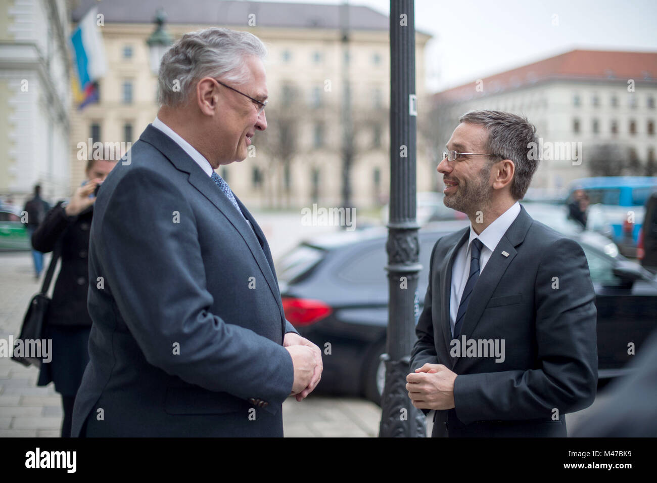 Munich, Germany. 15th Feb, 2018. Joachim Herrmann (CSU, L), Minister of Interior of the state of Bavaria, receiving Stock Photo
