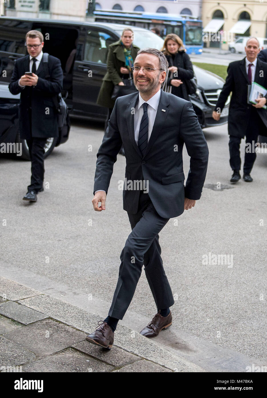 Munich, Germany. 15th Feb, 2018. Herbert Kickl (FPO), Austrian Minister of Interior, walking up to the gate of the Stock Photo