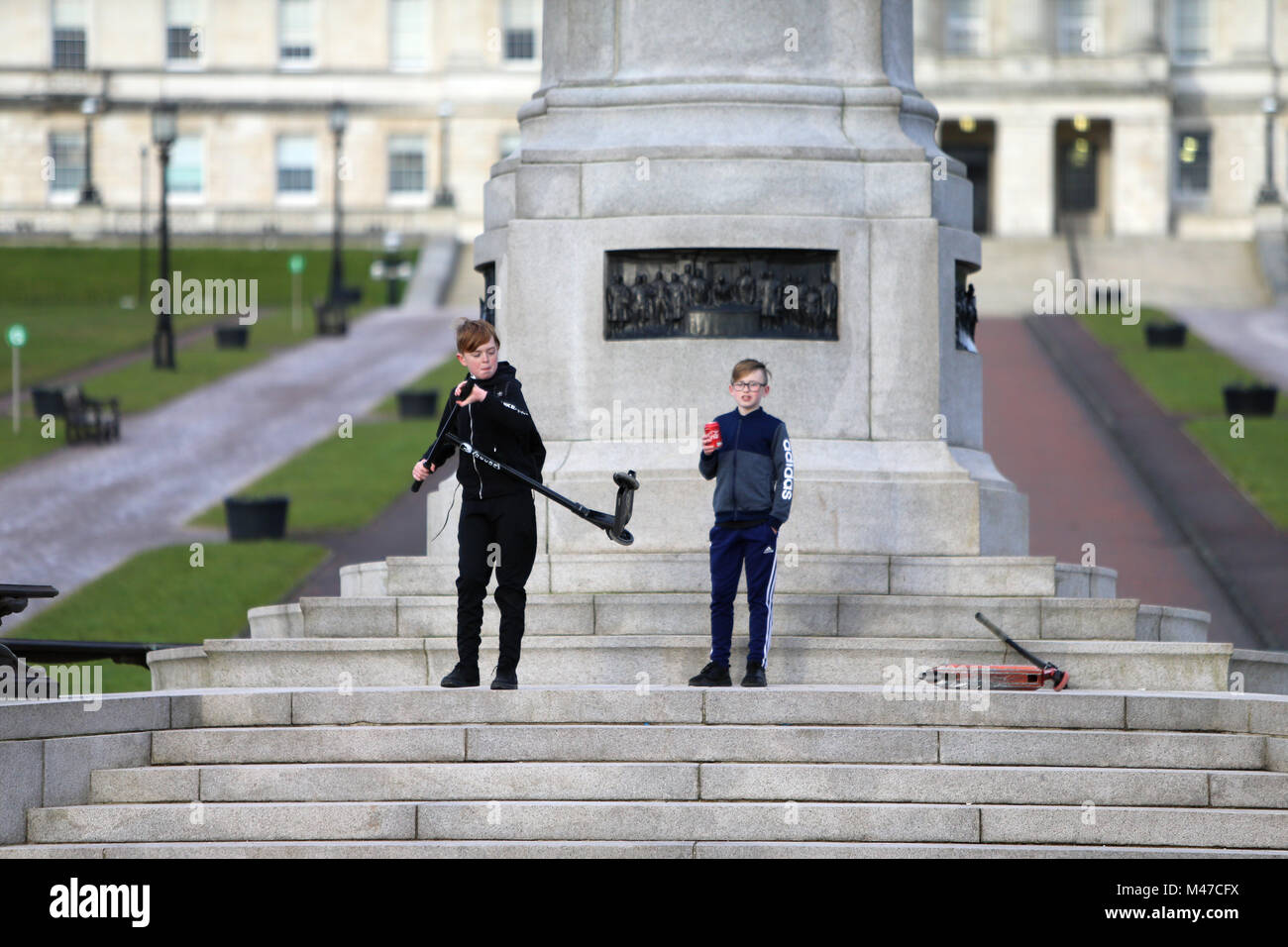 Two young boys play at the foot of Carson Staute at Stormont, east Belfast, Monday, Feb 12th, 2018. Britain's Prime Stock Photo