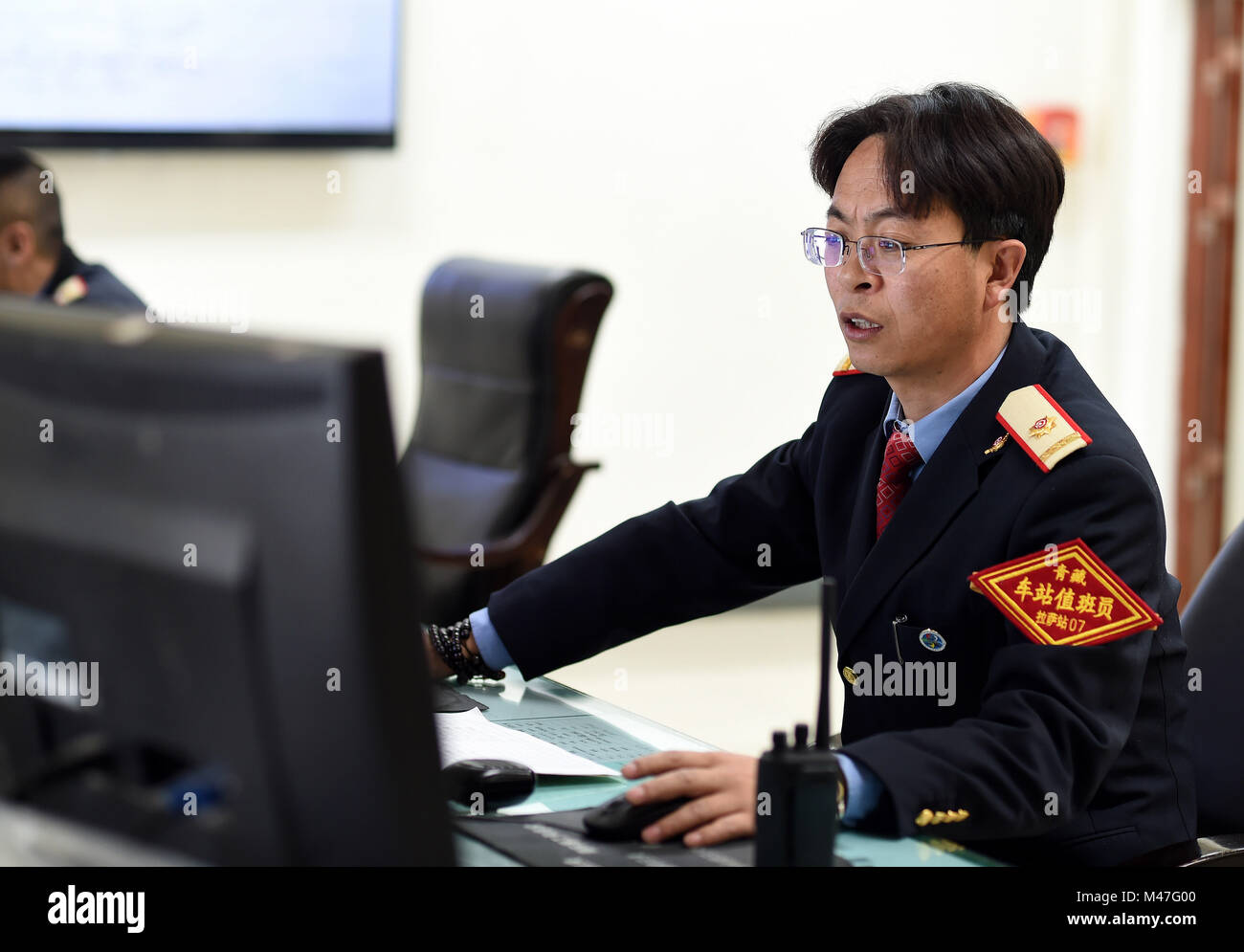 Lhasa, China's Tibet Autonomous Region. 15th Feb, 2018. A staff member works at Lhasa Railway Station in Lhasa, - Stock Image