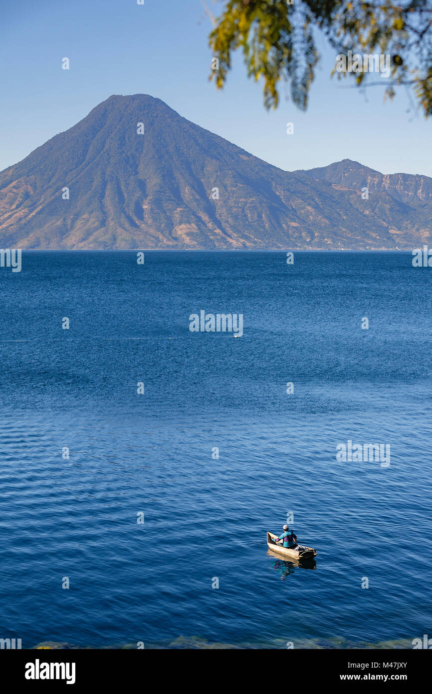 Fisherman in traditional wooden boat on Lake Atitlan. - Stock Image