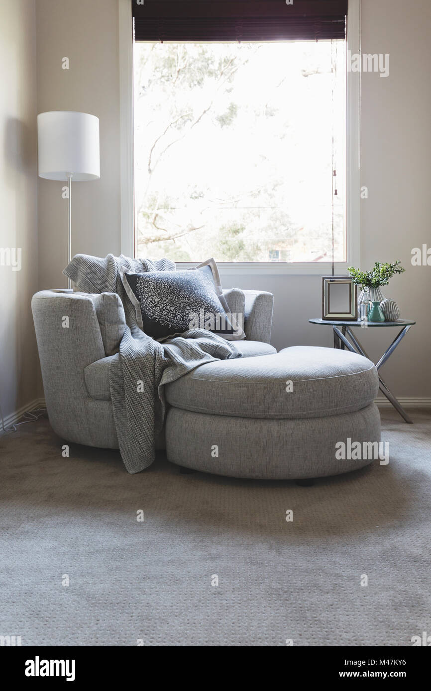 Luxury Grey Bedroom Corner Armchair Under A Window Stock
