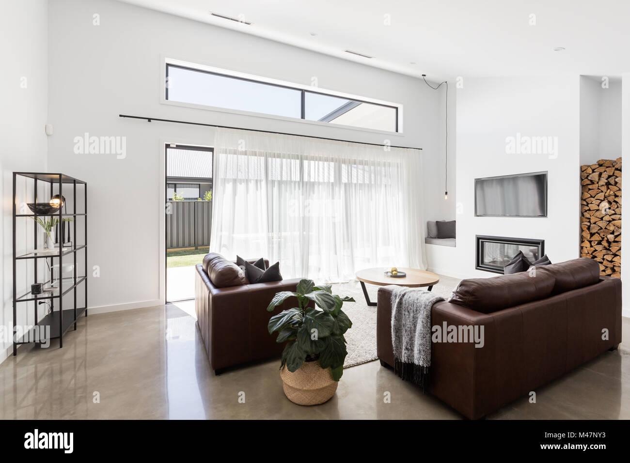 Modern open plan luxury living room with glass sliding doors Stock ...