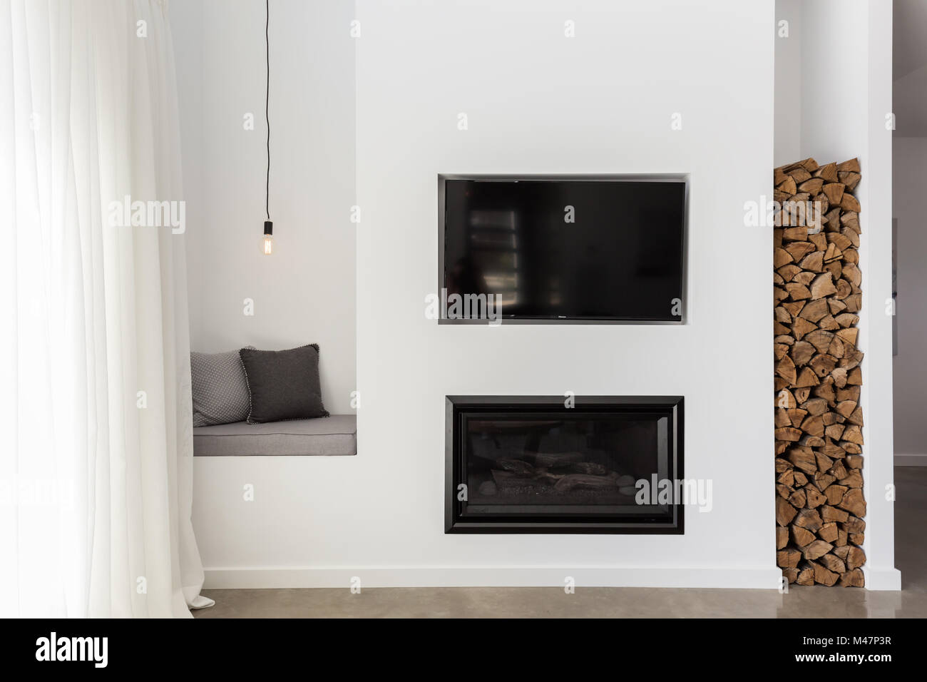 Built In Tv And Gas Fire In A Contemporary Living Room Stock Photo