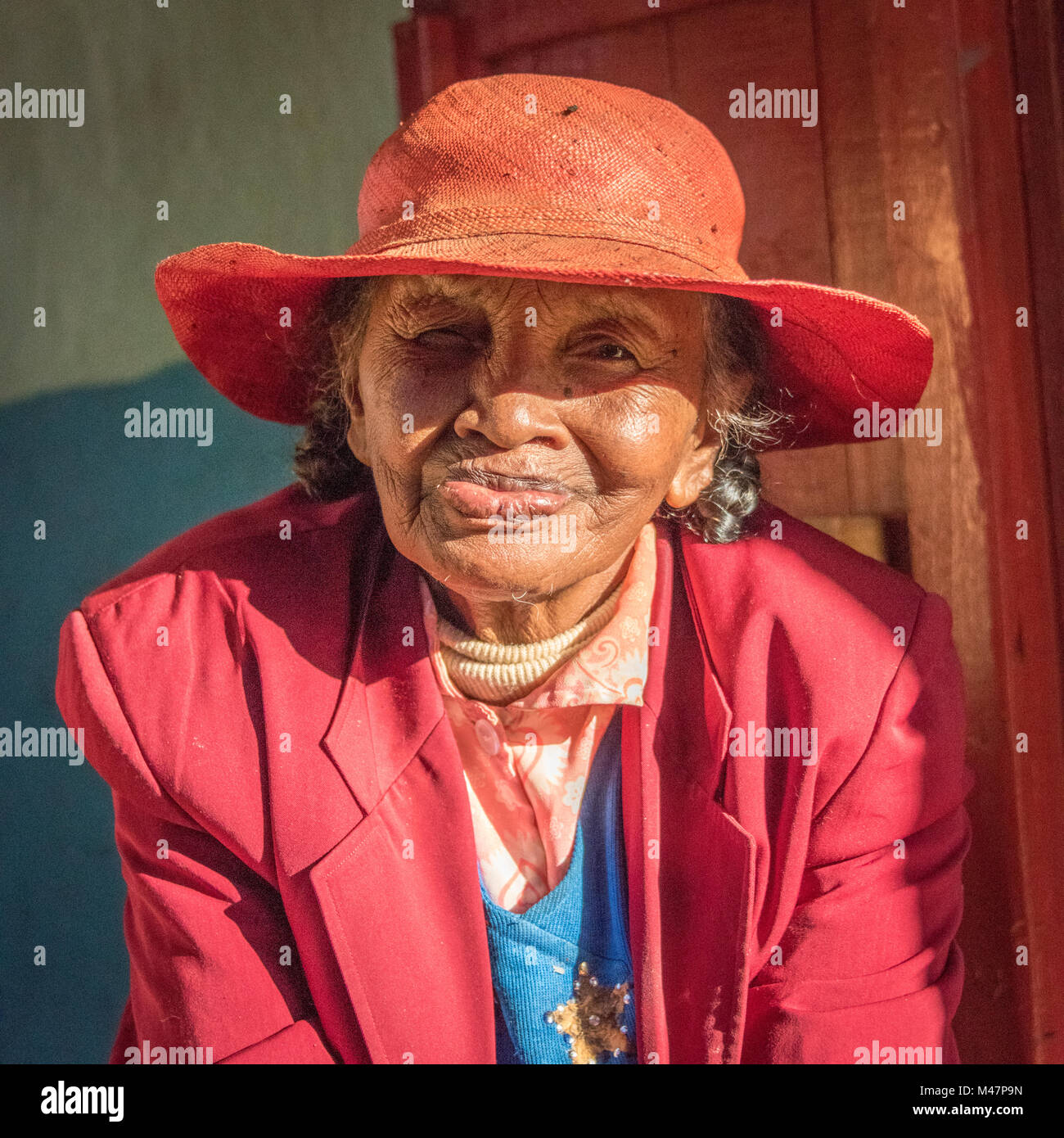 Elegant Malagasy Lady in Red - Stock Image