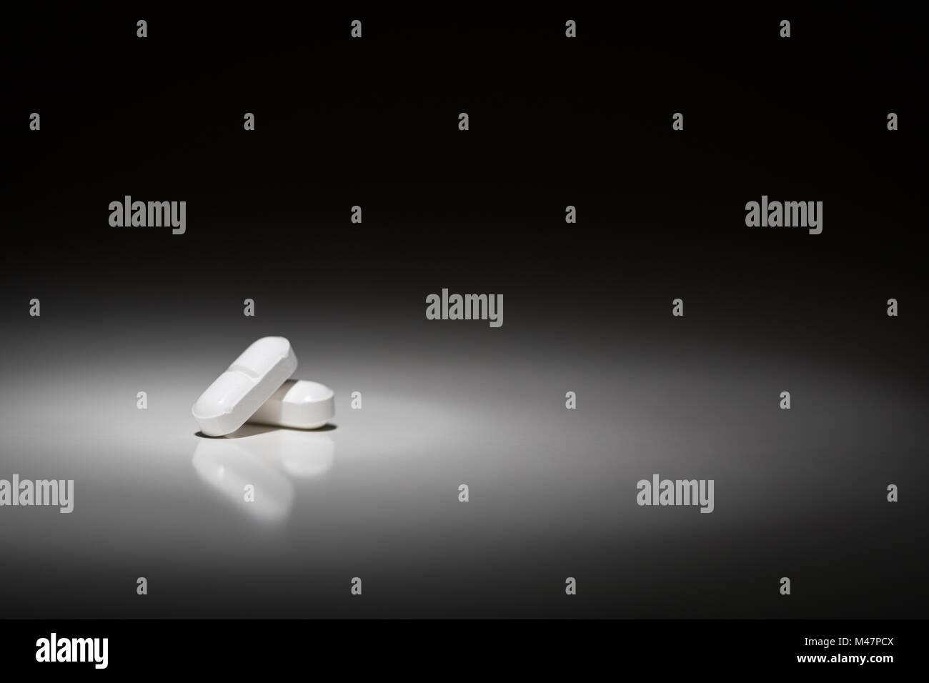 Hydrocodone Prescription Pills Under Spot Light. - Stock Image